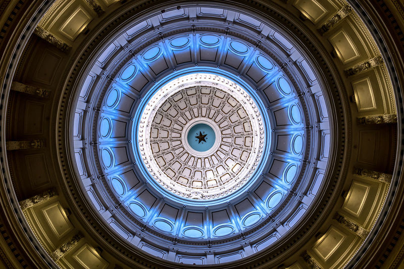 Capital Building Dome in Austin TX Arch Architectural Feature Architecture Austin Austin Texas Building Building Exterior Built Structure Capital Capital Cities  Ceiling Circle Design Directly Below Dome History Indoors  Low Angle View No People Pattern Spiral Staircase Staircase Steps And Staircases Texas Travel
