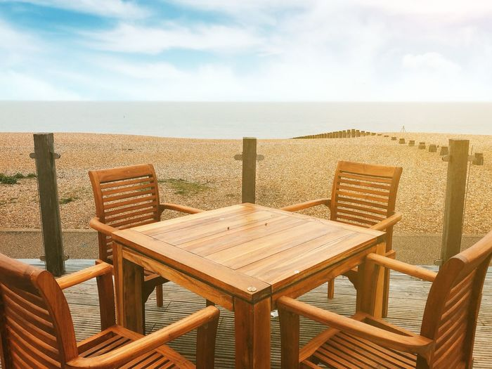 Beach Cafe in Sussex, UK Sussex Eastbourne Shingle Chair Sky Seat Sea Horizon Empty Cloud - Sky Table Water Nature Beauty In Nature No People Absence Horizon Over Water Tranquility Beach Tranquil Scene Wood - Material Day Land