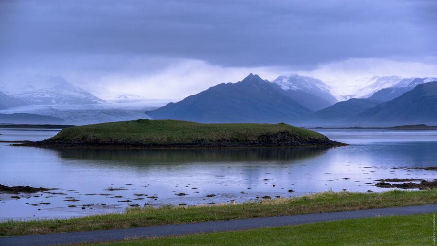 Scenic View Of Vatnajokull Glacier Against Cloudy Sky