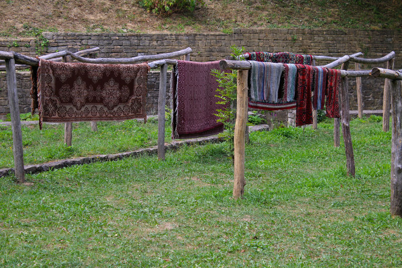 Ethnographic complex ETAR,Gabrovo Chores Clothes Clothes Line Clothesline Clothing Day Domestic Life Drying Fabric Field Freshness Grass Green Color Growth Hanging In A Row Laundry No People Outdoors Rack Sock Springtime Tranquility Washing