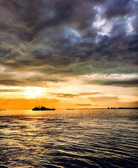 Dramatic Sky Beauty In Nature Sunset Cloud - Sky Sea Sky Dramatic Sky Transportation Nature Water Scenics Tranquility Nautical Vessel Orange Color Mode Of Transport Tranquil Scene Waterfront Silhouette Reflection Outdoors Horizon Over Water