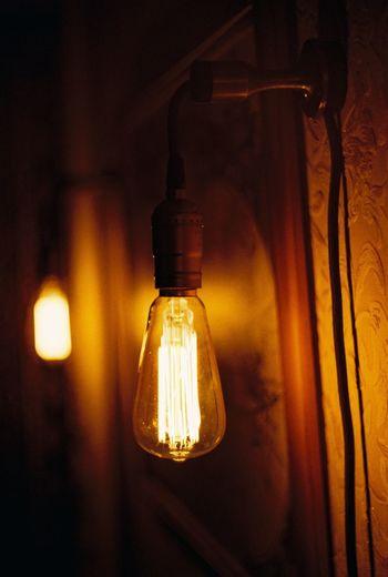 Close-up of illuminated light bulbs at home