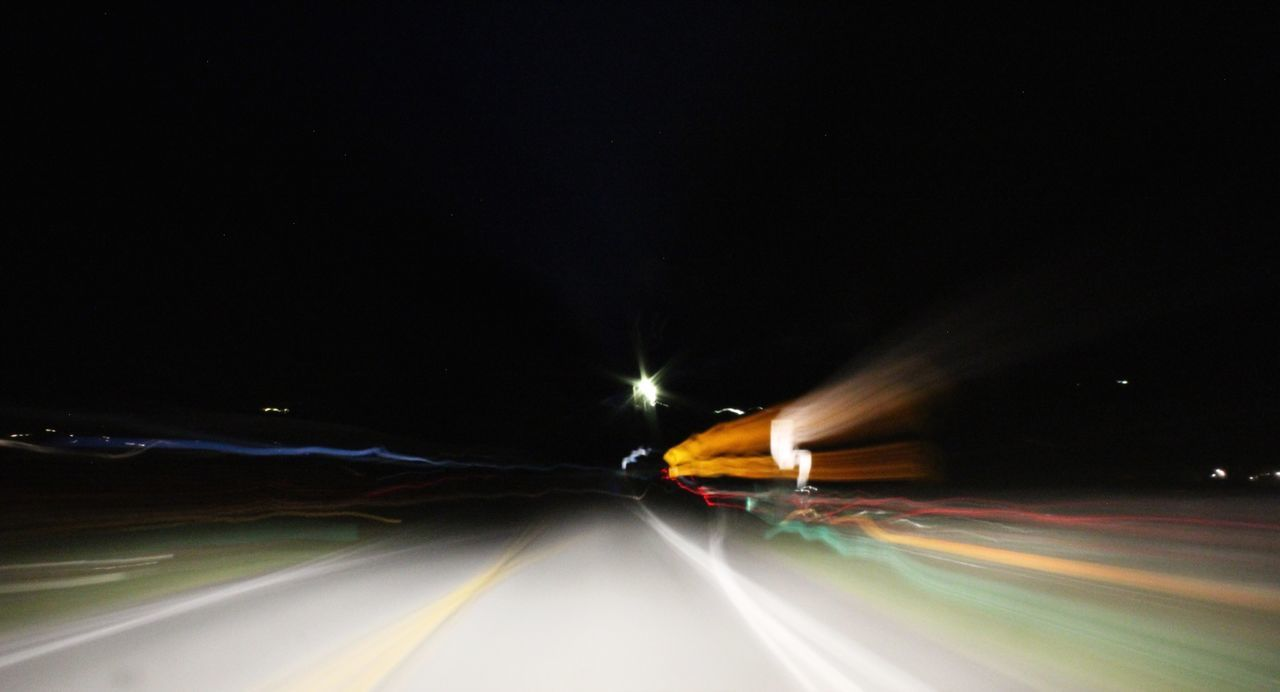 Surface level of light trails on street at night