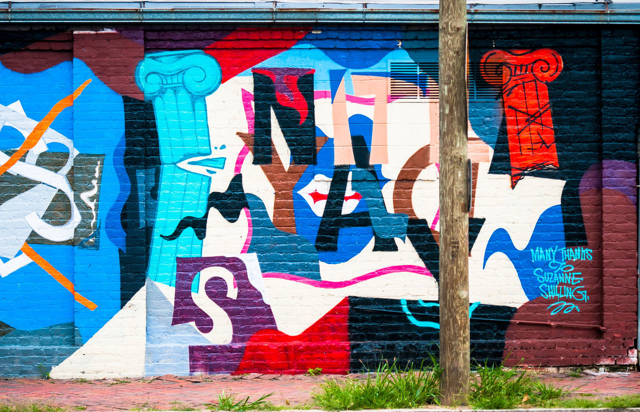graffiti, multi colored, art and craft, text, street art, creativity, architecture, built structure, colorful, day, building exterior, no people, outdoors, communication, paint, close-up