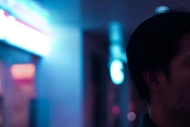 Man Indoors In An Illuminated Room