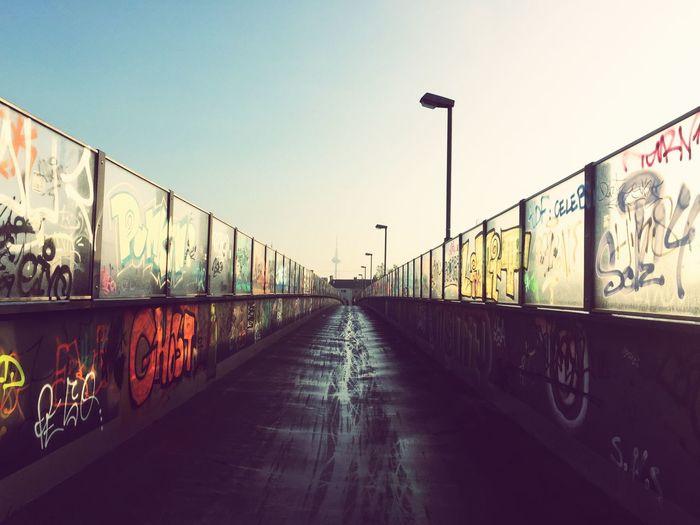Graffiti on bridge against clear sky