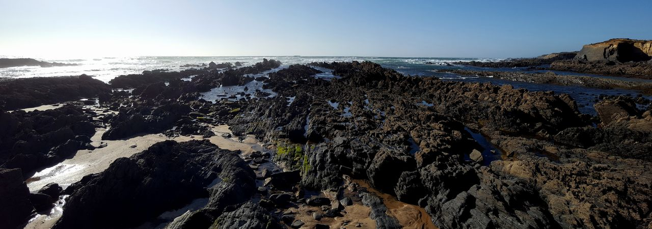 Beach Sea Power In Nature Water Clear Sky Sky Close-up Geology Rock Formation Coast Shore Cliff Rock