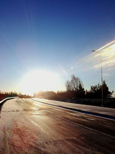 No People Sky Cold Temperature Sunlight Outdoors Winter Snow Finland Road Icy Road Bridge Street Lamp Bright Light Blue Sky
