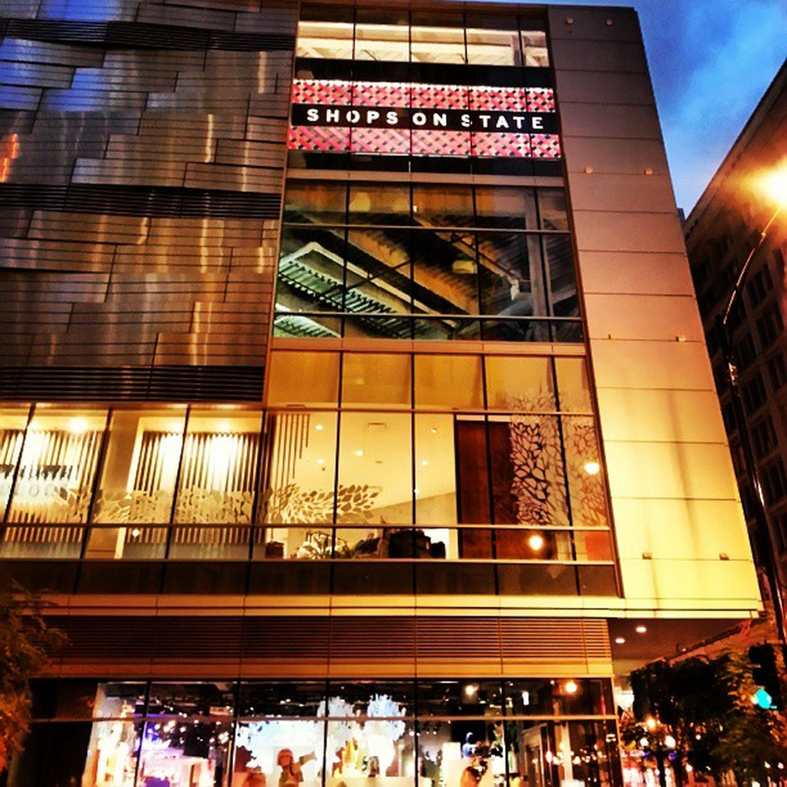 architecture, built structure, building exterior, low angle view, text, illuminated, city, window, building, glass - material, large group of people, non-western script, city life, western script, store, incidental people, modern, travel destinations, indoors, shopping mall