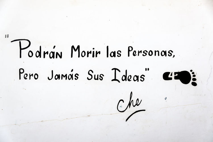 """LA HIGUERA, BOLIVIA - AUGUST 6: Quote by Che Guevara stating that """"People can die but not their ideas"""" in La Higuera, Bolivia seen on August 6, 2014 Argentina Argentinean Bolivia Che Guevara Communism Cuba Cuban Ernesto Che Guevara Guerrilla History La Higuera Memorial Monument Revolution Revolutionary South America Travel Vallegrande"""