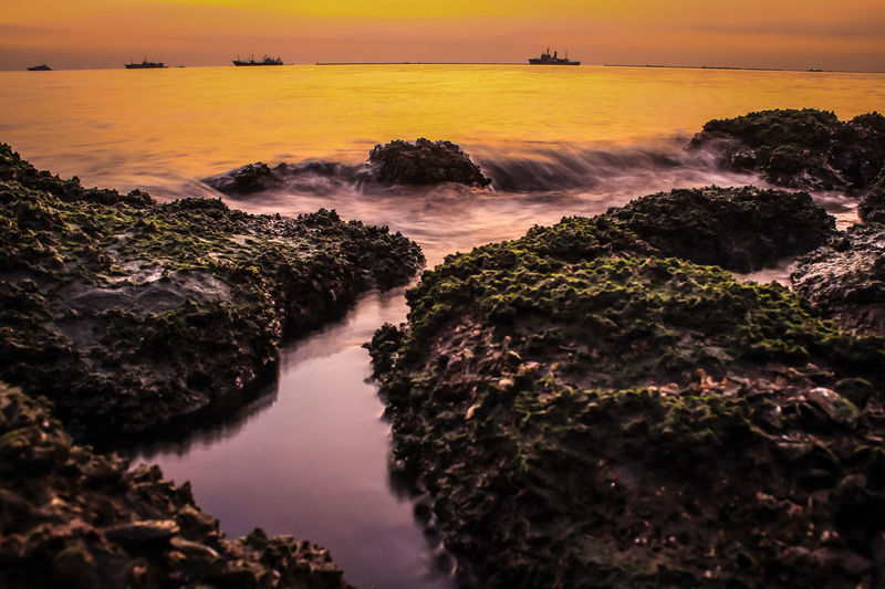 Silky Water Sunset Sky Sea Environment Land Nature Scenics - Nature Horizon Over Water Rock Landscape Sun Beauty In Nature Beach