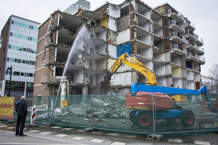 Hazardous Building Site Deconstruction Demolished Demolishing Buildings Demolition Demolition Equipment Demolition Flat Industrial Equipment Making Place For The New Man Looking Man Watching Old And New Buildings Rebuilding Safety Hazard Tools For Boys