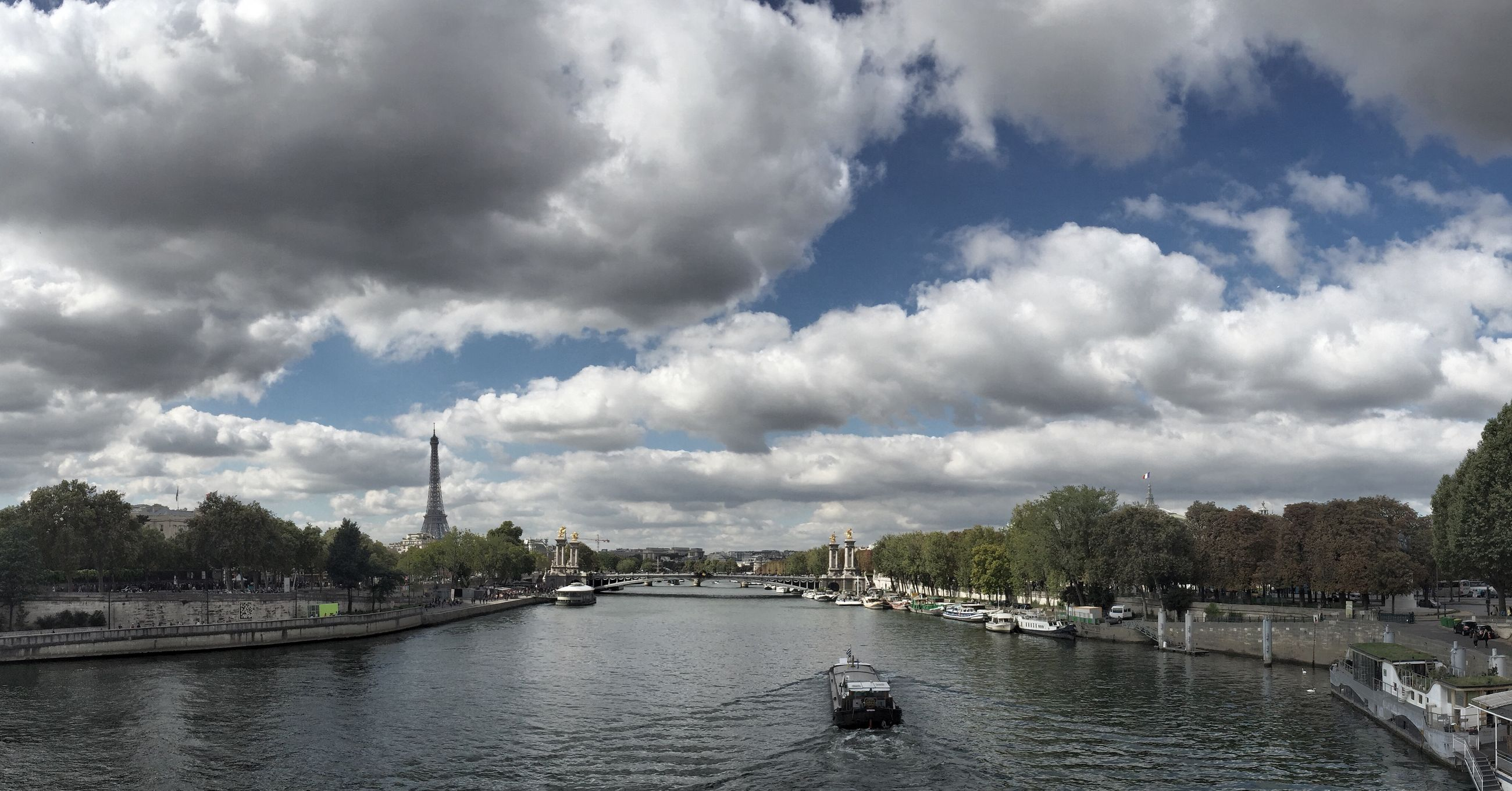 water, sky, cloud - sky, nautical vessel, cloudy, built structure, transportation, architecture, river, building exterior, waterfront, mode of transport, tree, boat, cloud, moored, harbor, nature, day, city