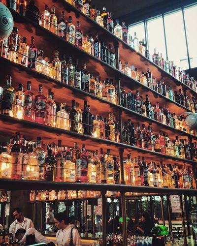 Full frame shot of bottles on display