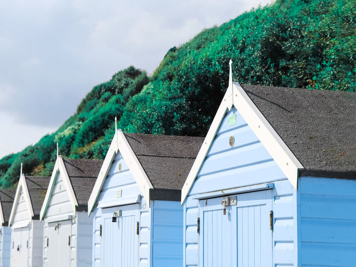 Beach houses Beachphotography Light Blue Light Pastel Power Seascape EyeEm Selects Tree Triangle Shape Sky Architecture Cloud - Sky Building Exterior Beach Hut Cabin Hut Roof Rooftop
