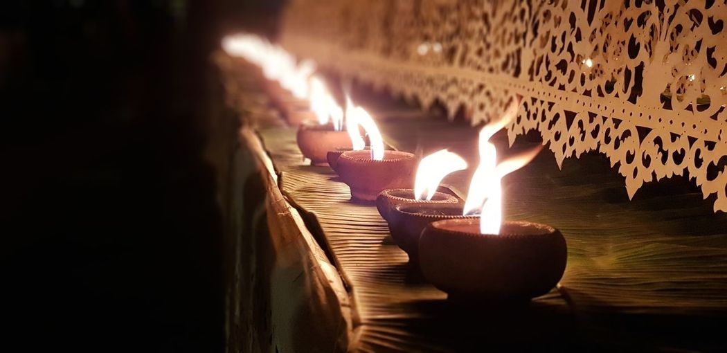 Close-Up Of Burning Diya On Table