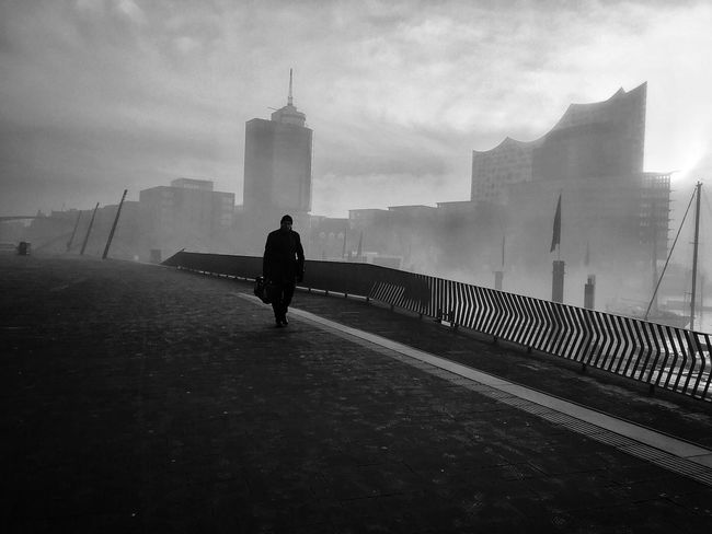 City Day Fog Cloud - Sky People Walking One Person Full Length Sky Real People Building Exterior Built Structure Architecture Harbour Hamburg Harbour Hamburgmeineperle Hamburger Hafen Blackandwhite Photography Blackandwhite Black And White Streetphotography Street Photography Streetphoto_bw Shades Of Winter