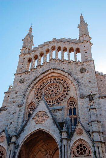 Cathedral of Soller, Mallorca Church Cathedral Soller SPAIN Mallorca Balearic Islands Spanish Architecture Sky Low Angle View Built Structure Clear Sky Building Exterior Belief Building Religion Place Of Worship The Past History No People Spirituality Travel Destinations Gothic Style Ornate