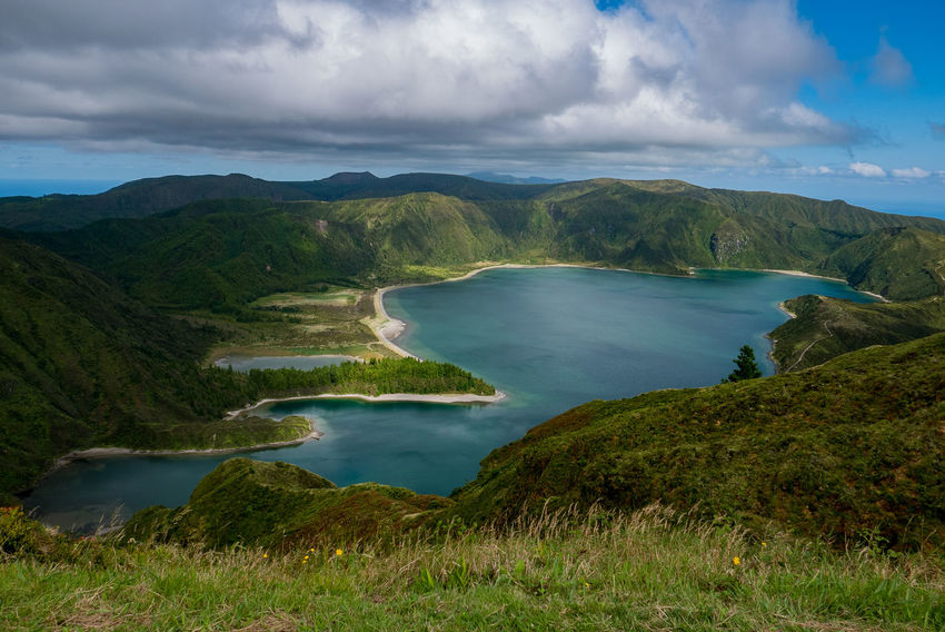 Beauty In Nature Cloud - Sky Day Green Color Landscape Nature No People Outdoors River Scenics Sky Social Issues Water Azores Azores Islands Azores Beauty Lagoa Do Fogo Portugal_em_fotos Portugal Sky And Clouds Lagoon Vulcan Crater Lake Vulcanic Craters