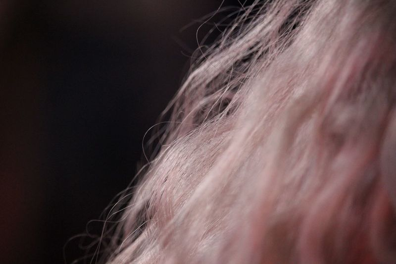 Close-up of woman hair against black background