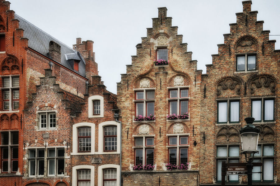 Detail of ornate old buildings in the medieval West Flanders city of Brugge / Bruges in Belgium Architecture Belgium Brugge Flanders Steps Wall Architecture Brick Brick Building Bruges Building Building Exterior Buildings Built Structure City Day Flemish Flemish Architecture Gable Lookingup No People Outdoor Photography Outdoors Window Windows