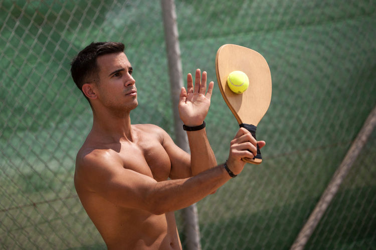 Athlete Ball Beach Tennis Beachphotography Competition Healthy Lifestyle Holding One Person Playing Rackets Shirtless Sport Standing Tennis Ball Young Adult Young Men