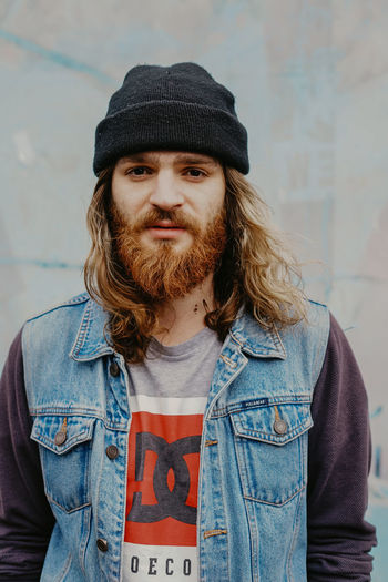 The Portraitist - 2019 EyeEm Awards One Person Front View Casual Clothing Beard Looking At Camera Hat Lifestyles Young Adult Facial Hair Real People Portrait Clothing Leisure Activity Wall - Building Feature Waist Up Standing Young Men Brown Hair Hairstyle