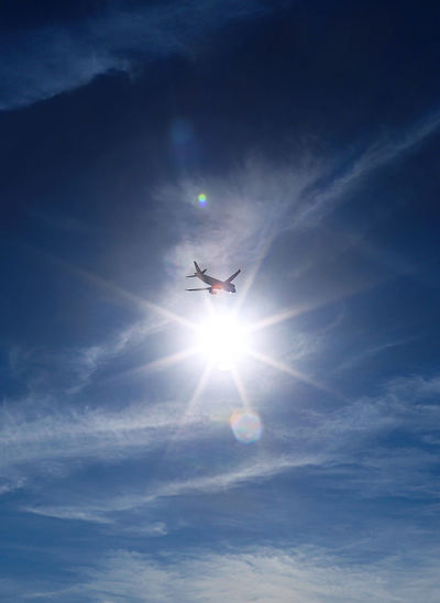 Air Vehicle Airplane Blue Cloud - Sky Day Flying Low Angle View Mid-air Nature No People Outdoors Silhouette Sky Sun Sunbeam Sunlight Sunset Transportation