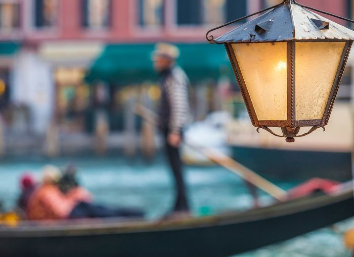 Close-up of illuminated lamp in canal