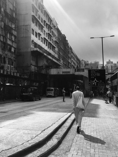 Built Structure Architecture Building Exterior Real People Men Rear View Full Length Outdoors City Walking Day City Life Lifestyles Sky Adult People Hong Kong Tim Wong