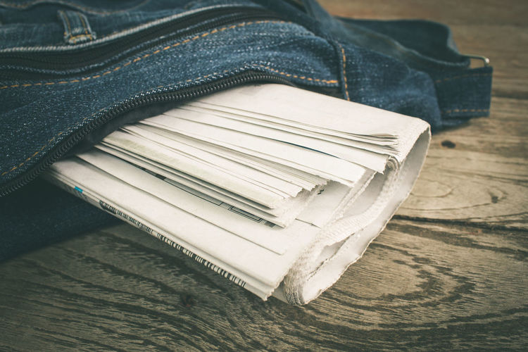 Classic Newspapers Retro Retrostyle Book Classical Close-up Denim Education Folded High Angle View Jeans Leather Newspaper Newspaper Pics One Person Paper Publication Retro Style Retro Styled Stack Still Life Table Textile