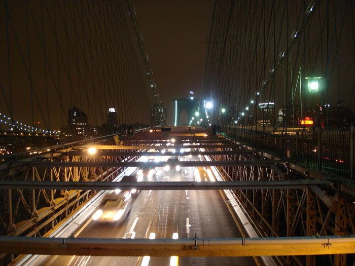 Illuminated Traffic On Brooklyn Bridge At Night