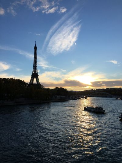 Silhouette of eiffel tower against sky during sunset