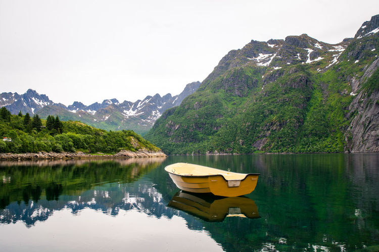 The boat and the mountain. Mountain Water Beauty In Nature Scenics - Nature Tranquility Lake Tranquil Scene Reflection Nautical Vessel Mountain Range Plant Tree Sky Nature Idyllic Day Non-urban Scene Mode Of Transportation Waterfront No People Outdoors Boat Lofoten Norway Norge