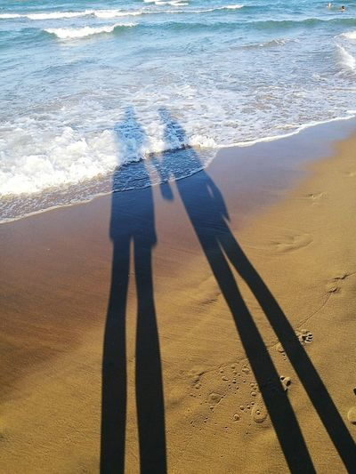 Shadow Sand Sunlight Real People Beach Focus On Shadow Outdoors Leisure Activity Love Girlfriend & Boyfriend Complicity