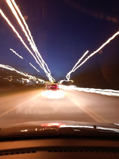 Light trails on road in city