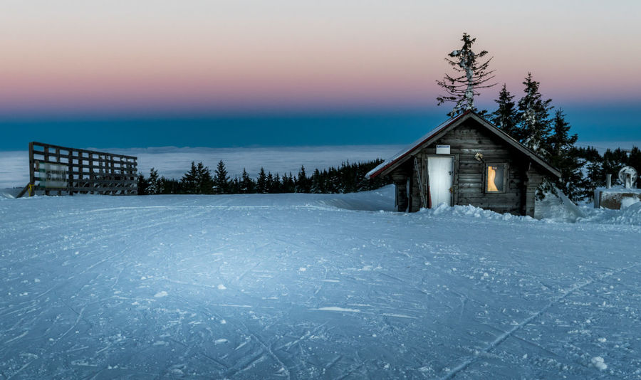 Cabin in the mountains in winter at sunrise Log Cabin Abandoned Architecture Building Exterior Built Structure Cold Temperature Dusk Frozen House Ice Illuminated Landscape Nature Night No People Outdoors Rural Scene Scenics Sky Snow Spooky Sunset Tranquil Scene Tranquility Winter
