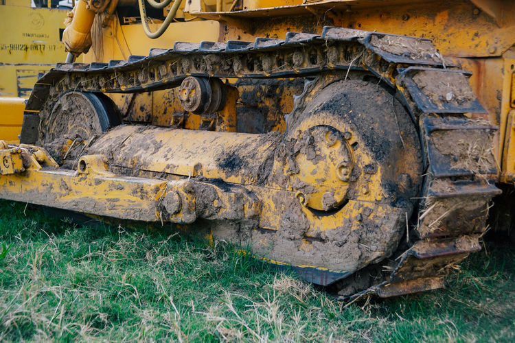Close-up of earth mover on field