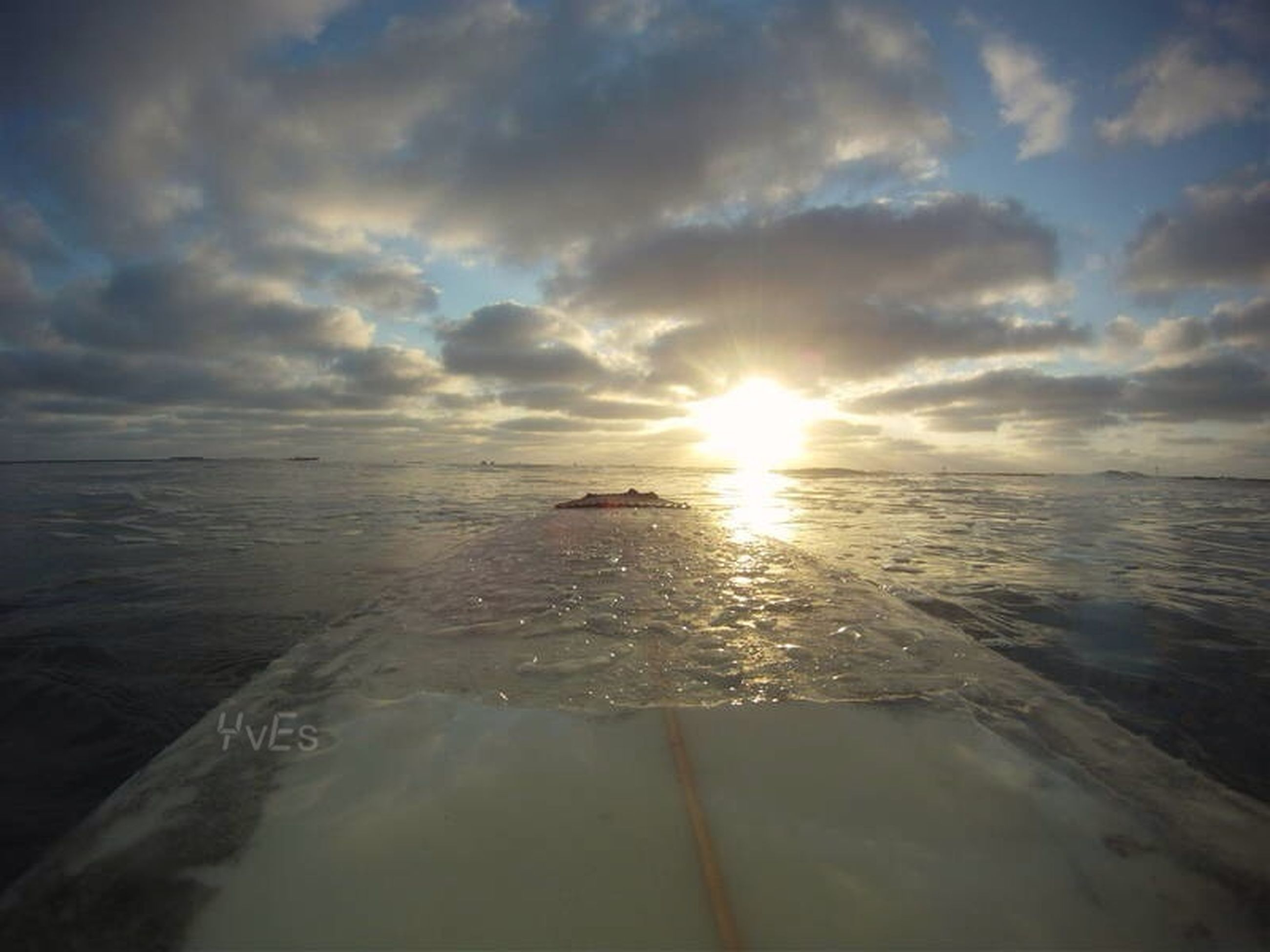 sea, water, sun, horizon over water, sunset, scenics, sky, tranquil scene, beauty in nature, tranquility, reflection, beach, sunbeam, cloud - sky, sunlight, nature, shore, idyllic, wave, lens flare