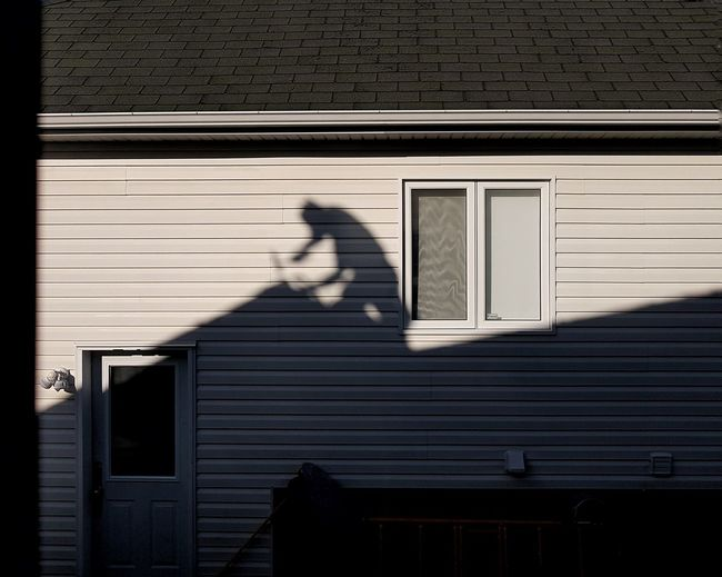 1-day job DONE ... Suburban Suburbia House Window Man At Work Shadow Man On Rooftop darkness and light Early Morning Light City Shadow Sunlight Architecture Building Exterior Built Structure Focus On Shadow Door Closed Door A New Perspective On Life