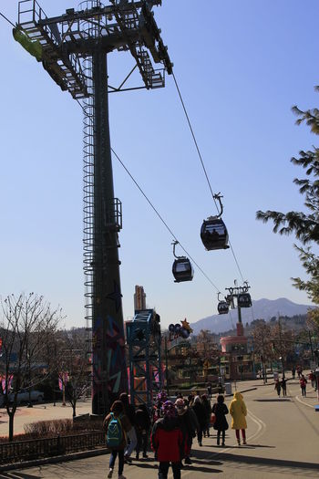 Cable car with blue sky background in Korea Sky Tree Nature Real People Street Transportation Group Of People Architecture City Clear Sky Cable Plant Day Mode Of Transportation Outdoors Lighting Equipment Cable Car Electricity  Blue Blue Sky