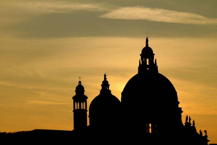 Silhouette cathedral against sky during sunset