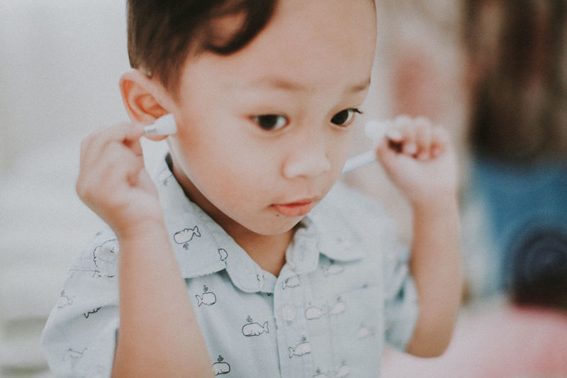 Close-Up Of Cute Boy Holding Stethoscope At Home
