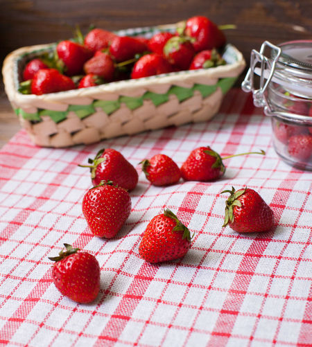 Close-Up Of Strawberries In Basket On Wooden Table