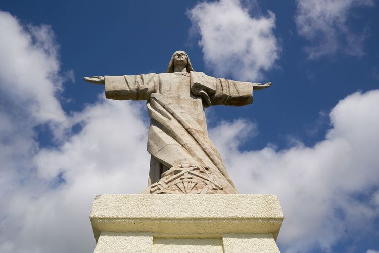 Cristo Rei Jesus Christ sculpture in Caniço, Madeira Madeira Travel Island Portugal Portuguese Europe Religion Belief Cross Statue Architecture Cristo Rei Christianity Christian Jesus Christ Spirituality Sculpture Arms Raised Catholic Panorama Panoramic Faith Aerial View God Outdoors
