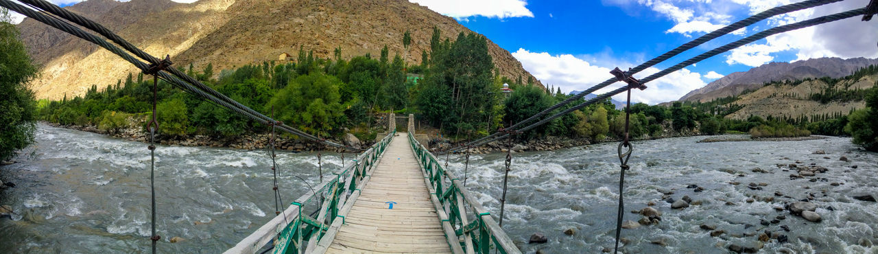 A semi wooden bridge used by villagers to fetch food across the river. Arrow Wooden Bridge Hills Panorama Path River Valley Water Wild First Eyeem Photo Nature Outdoor