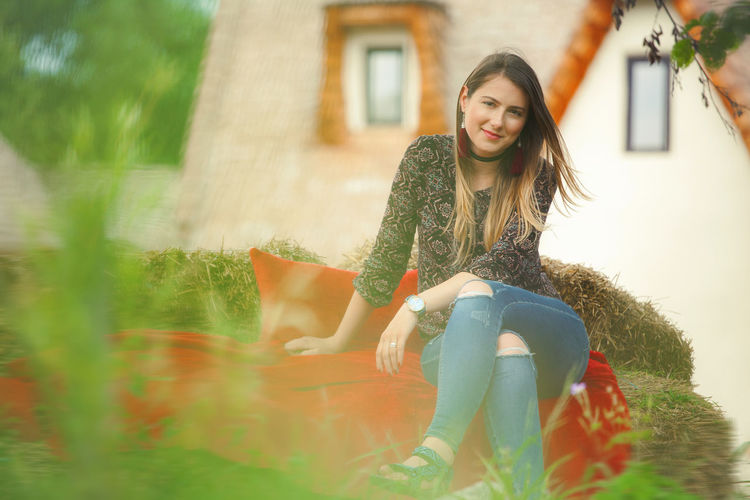 Artistic and natural portrait of beautiful woman in the nature. Woman Face Portrait Beautiful Beauty Smile Female Girl Young Hair Natural Nature Outdoors Skin White Happy Attractive Background Lifestyle Fashion Cute Red Couch Green Sitting One Person Leisure Activity Lifestyles Young Adult Full Length Smiling Long Hair Casual Clothing Real People Selective Focus Architecture Day Women Young Women Beautiful Woman Adult Hairstyle