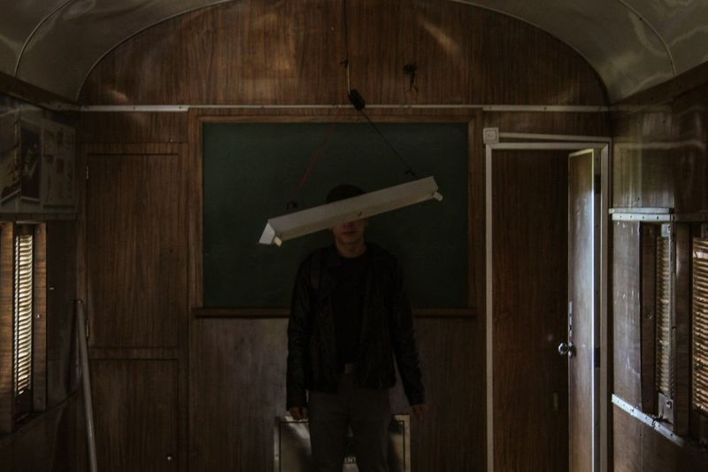 Man standing by lighting equipment