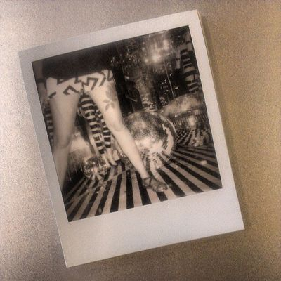 Favorite shot from last night. Made with Impossibleproject Px100 SX70 Silvershade  TheNettedPigeon mirrors instantaday