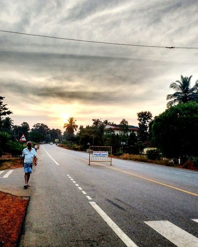 India Highway Sunset Mangalore Indianroads Mobile Photography Clouds Sun Emptyroads Contrast And Lights Road Cloud - Sky Transportation Street Tree The Way Forward Sky Outdoors One Person People Only Men Adults Only One Man Only Adult